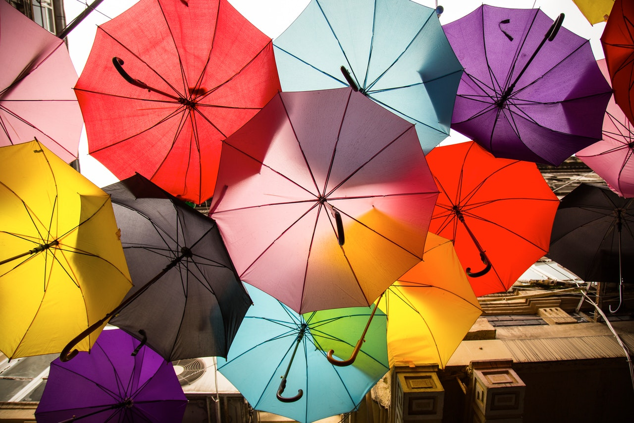 Social distancing helped by shed of umbrellas outside Arunachal bank